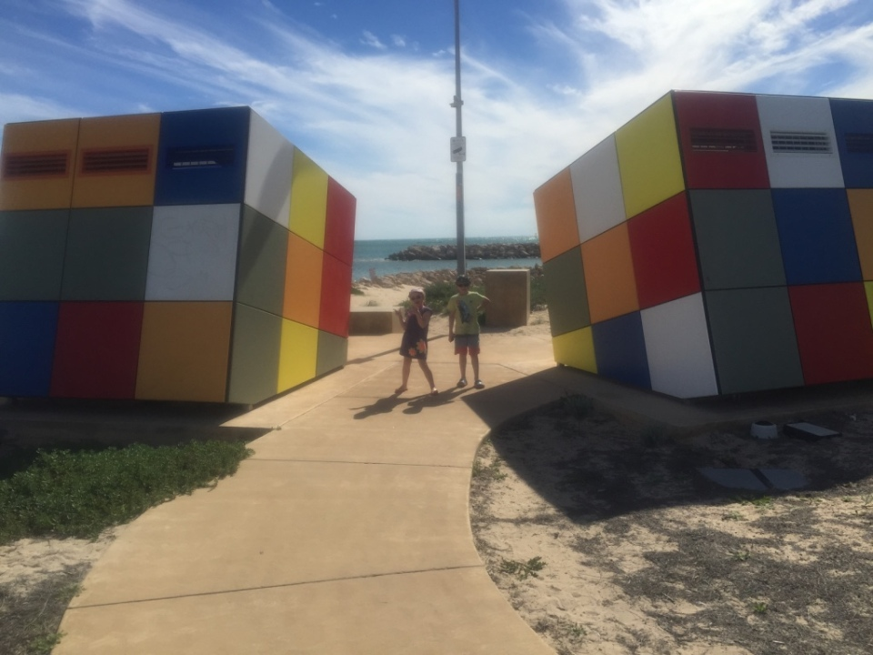 Kids with BIG Rubix Cube - these were actually cool public toilets on the water front.