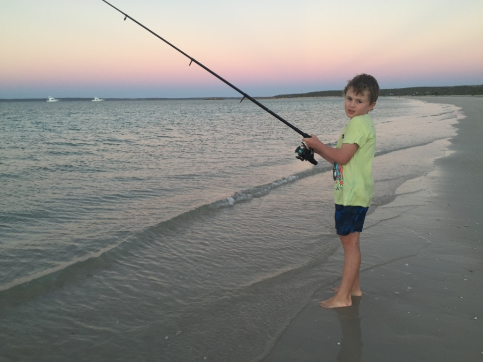 Aaron fishing off our beach.