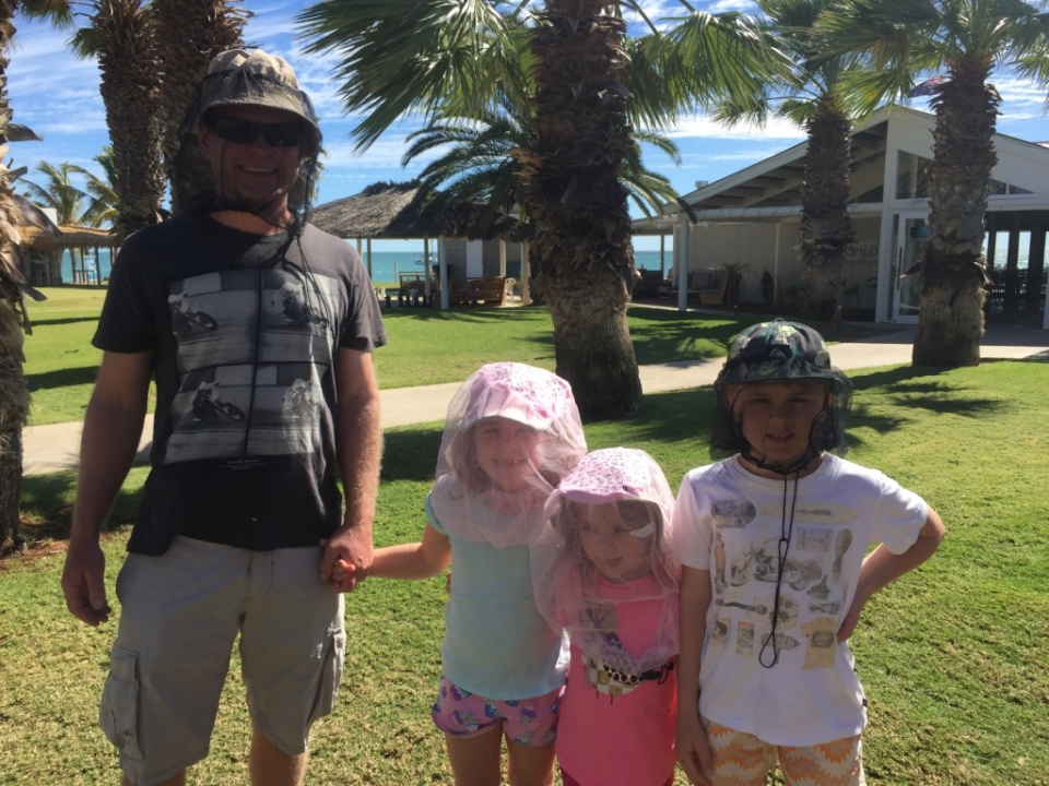 Family happy with new fly net purchase.