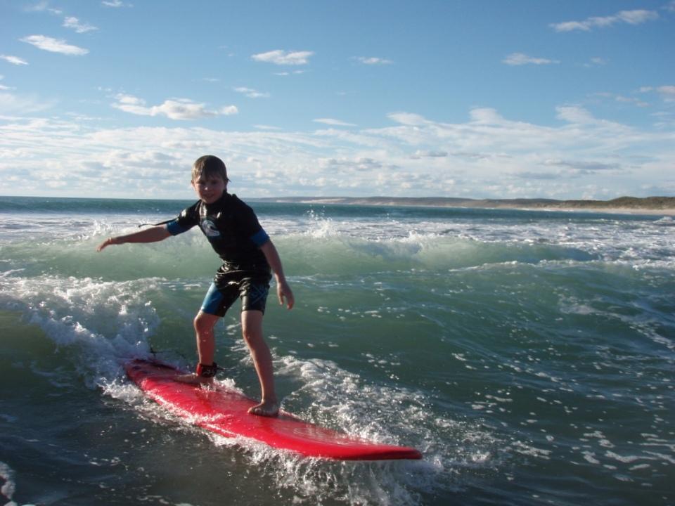 Aaron catching waves at Jakes at Kalbarri.