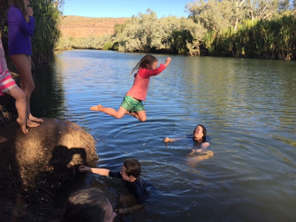 Bianca jumping into the Hann river at Bluebush swim hole