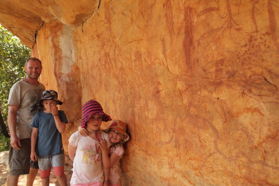 A wall of rock art that had multiple layers of different drawings