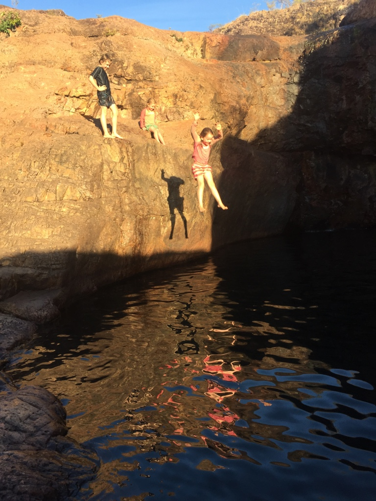 Jumping into Surprise Creek rock holes